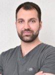 врач Даурбеков Ислам Исропилович